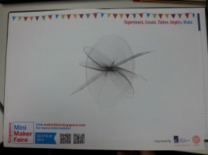Harmonograph drawing on Singapore Mini Maker Faire 2013 design paper