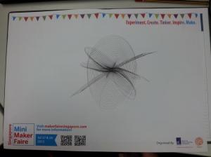 Harmonograph drawing on Singapore Mini Maker Faire 2013 design paper