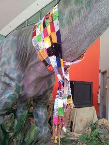 yarnbombed dinosaur